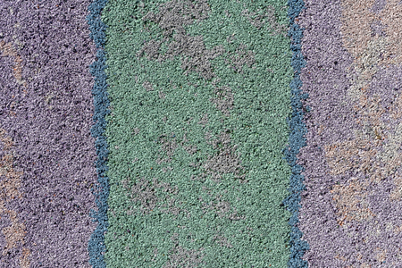 floor mats: Colorful surface as background - violet, green, blue, diagonal strips. Safety rubber floor mats. Children playgrounds and outdoor recreations