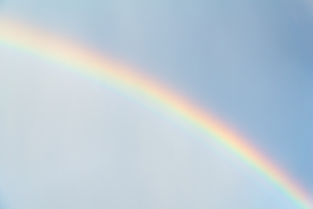 Rainbow in blue sky after the rain - physical phenomenon - as background