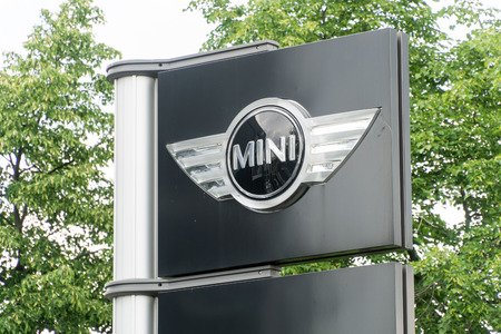 cooper: WARSAW, POLAND, May 21, 2016: Mini sign. MINI Cooper automobile dealership sign and logo. MINI Cooper is a brand of car made by BMW.