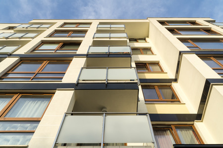 residential: Modern residential building facade with balconies. Bottom view