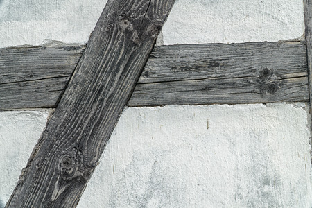 Detail of the timber frame. White wall and dark bars. Stock Photo