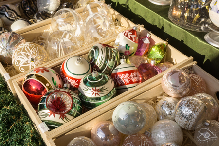 Christmas ornaments. Christmas market store - Christmas decorations in wooden boxes. Stock Photo