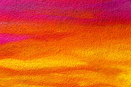 Colorful roughcast texture. Yellow orange purple background
