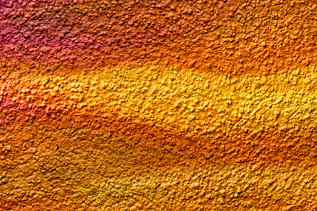 roughcast: Colorful roughcast texture. Yellow orange brown background
