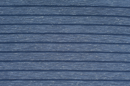 Knitwear in blue striped. Textured background. Stock Photo