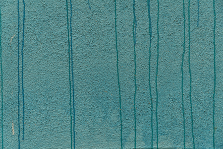 Abstracte turkooise achtergrond. Detail van een graffitikunst op een muur. Textuur van geschilderde muur.