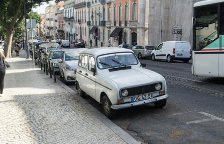 LISBON, PORTUGAL - SEPTEMBER 3, 2018: White Renault 4  car oldtimer  parked on the street if Lisbon.