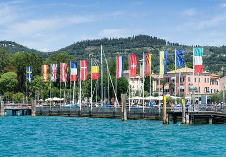 BARDOLINO, GARDA LAKE, ITALY - AUGUST 7, 2017: The view of harbour captured from the Garda Lake (Lago di Garda), Bardolino is a popular holiday destination, is located in northern Italy.
