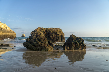 Rock formations on a Praia da Rocha in Portimao, Algarve region, Portugal. Late afternoon of sunny summer day.