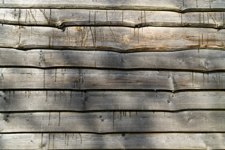 Fence from horizontal raw old gray old boards. Wood texture background.