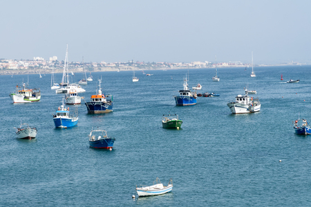 CASCAIS, PORTUGAL - September 2, 2018: Fishing boats floating in the fish port of Cascais.
