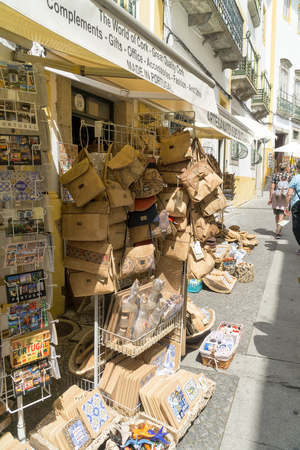 EVORA, PORTUGAL - SEPTEMBER 04, 2018: Undefined tourists shopping in the main street of the Evora. A typical souvenir from Evora is cork products: bags, hats; vallets etc.