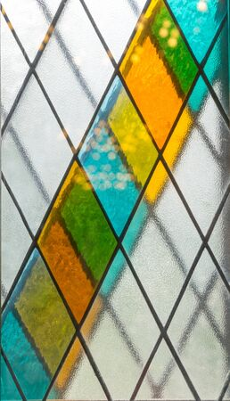 Stained glass. Colorful background of tiles with diagonally arranged parallelograms. Banque d'images