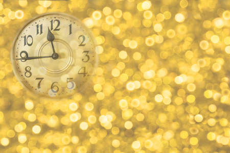 Retro style clock counting last moments before Christmass or New Year. Christmas and new years invitation golden horizontal background.