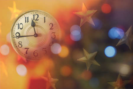 Retro style clock counting last moments before Christmass or New Year. Christmas and new years invitation colorful horizontal background. Reklamní fotografie