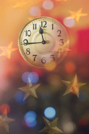 Retro style clock counting last moments before Christmass or New Year. Christmas and new years invitation colorful vertical background.