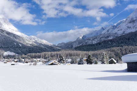 Ehrwald Valley, Tirol, Austria. Winter mountain landscape, Sunny day with white clouds on blue sky.