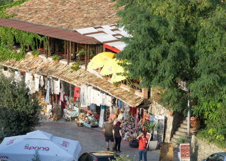 KRUJA, ALBANIA - SEPTEMBER 16, 2019: street market with souvenirs, craft items and small shops in Kruja (Kuje) Albania, Europe.