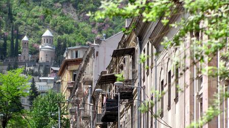 rustaveli: Tbilisi main street, trees and church on the background Stock Photo