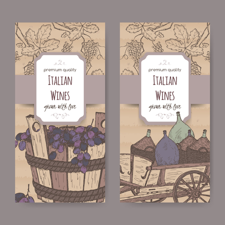 tuscan: Set of 2 elegant Italian wine label templates with wine bottles in traditional cart and grapes in wooden bucket. Placed on cardboard background. Great for wineries, grocery stores, wine label design.