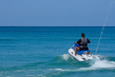 jetski: Driving Jetski near HoletownBarbados;  photographed in October 2007