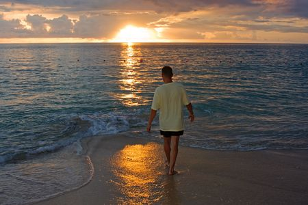 Man on the beach photgraphed in Holetown, Barbados photo