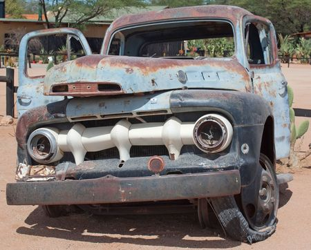 rusty car: a rusty car in Namibia; photographed in October 2009