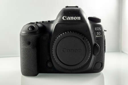 Frankfurt, Germany - 21st March 2021: A german photographer taking pictures of the Canon EOS 5D Mark IV camera body from all sides incl. Buttons and connections in order to sell it on eBay.