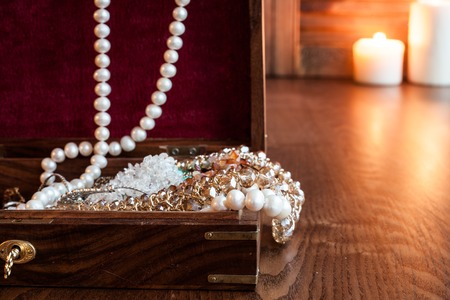 bead jewelry: Beads in wood box on a table. Open Treasure Chest Stock Photo