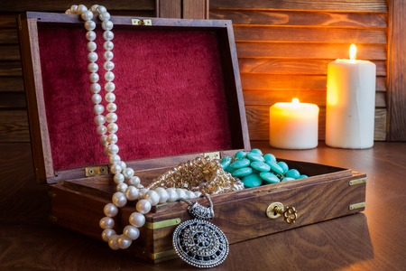 treasure: Beads in wood box on a table. Open Treasure Chest Stock Photo