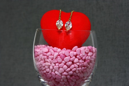 Earrings on the heart shaped object photo