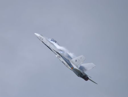 manoeuvre: navy supersonic fighter-attack plane pulling high g manoeuvre