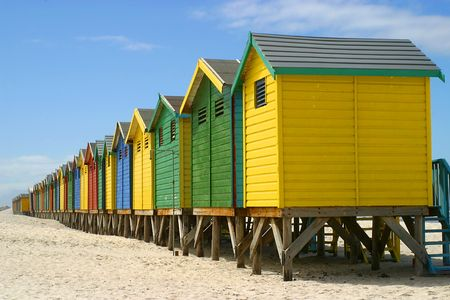 stilts: Colorful wooden cabins for changing clothes on beach in South Africa, constructed on stilts