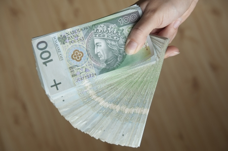 Woman hand holding a lot of Polish money Stock Photo
