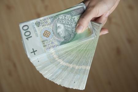 Woman hand holding a lot of Polish money Stock Photo