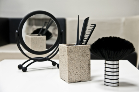 Hairdresser accessories - mirror, brush and combs Stock Photo