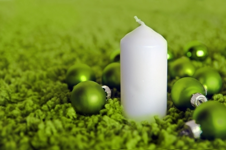 Green christmas balls and white candle Stock Photo