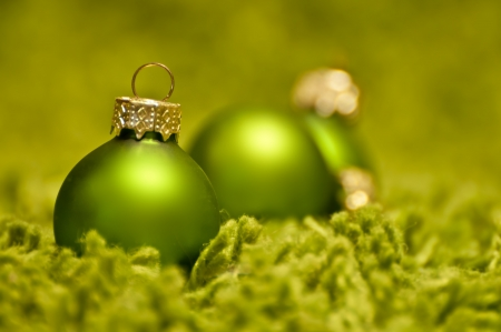 Green christmas balls on green carpet