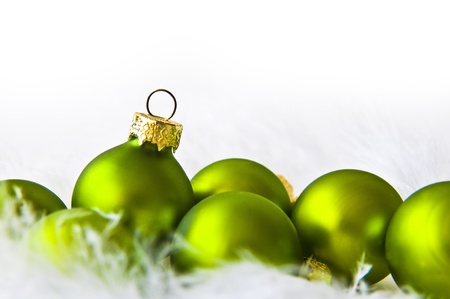Green christmas balls on white background Stock Photo