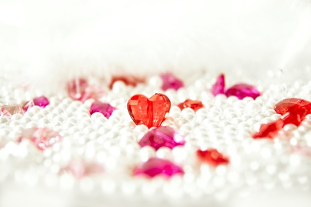Love background with heart-shaped crystals