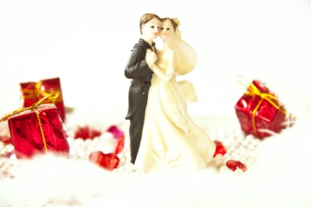 Wedding figurines with gifts on white background Stock Photo