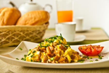 Scrambled eggs with mushrooms - healthy breakfast Stock Photo