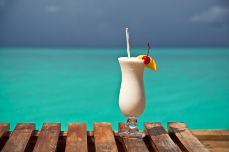 White drink and turquoise water at a holiday resort