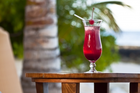 Pink - red drink at a beach bar  Stock Photo
