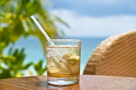 Glass with a cold drink at a beach bar