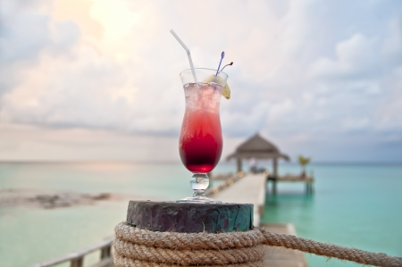 Pink - red drink by turquoise sea