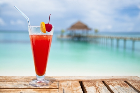 Red - orange drink by turquoise sea