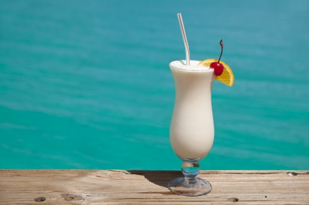 White drink by turquoise sea