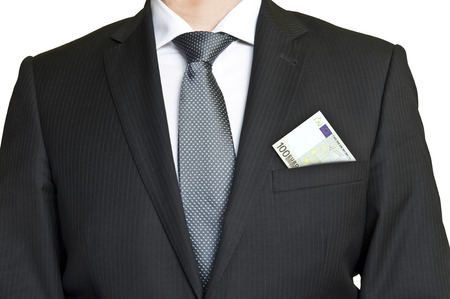Businessman wearing suit and tie with 100 euro banknote in pcket