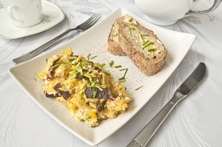 wholesome: Tasty breakfast - scrambled eggs, wholesome bread and tea on white background